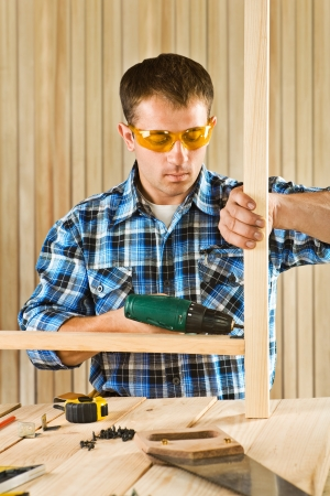 screwdriwer: young men works with screwdriver