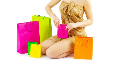 a girl loking in paper  bags Stock Photo - 18797227