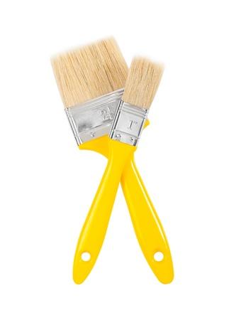 yellows: two yellows paintbrushes Stock Photo