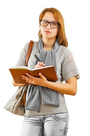 hipster girl writing with ballpoint pen photo