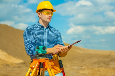 a contractor writing in clipboard photo