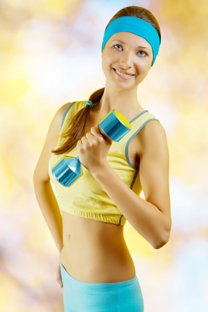 a sports girl wih dumbbell photo