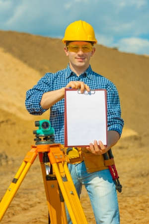 a worker holding empty clipboard photo