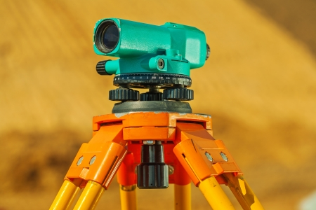 tacheometer: theodolite on on blurry background