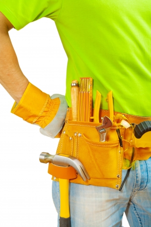 class maintenance: tools in belt on worker Stock Photo