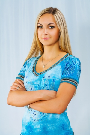 beautyful blonde on blue background photo