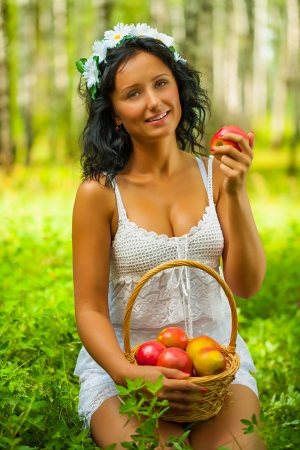 a young female holding apple photo