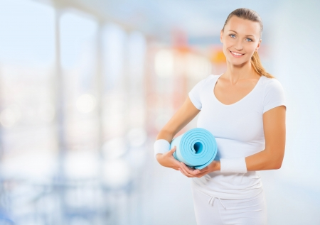 a fit woman with sport mat photo