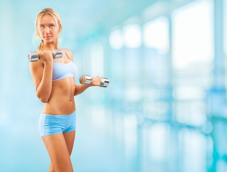 a sports  girl holding weights photo