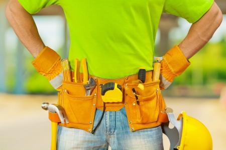tools in belt of worker