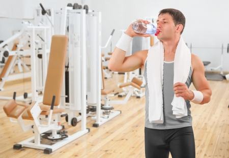 water aerobics: a sportsman drinking water from bottle Stock Photo