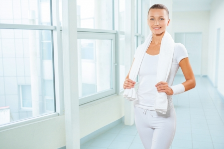 a sportswoman in white clocthes with cotton towel photo