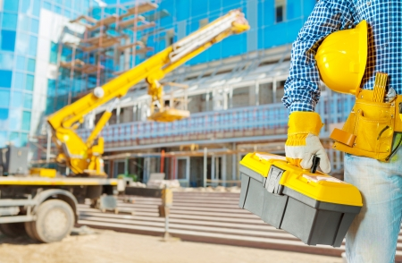 class maintenance: contractor with tools on construction site