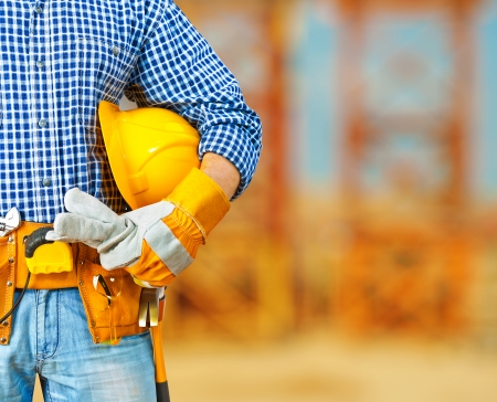 class maintenance: worker on construction site Stock Photo