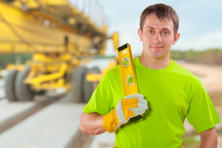 costruction: a worker with costruction level Stock Photo