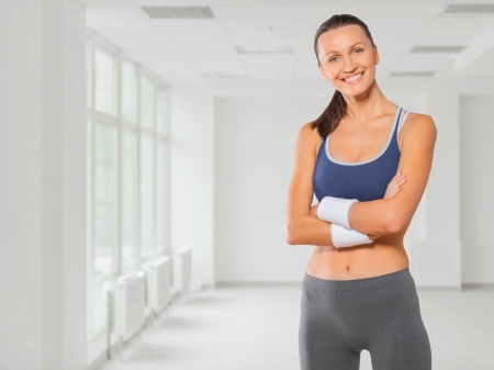 beautiful fitness girl smiling arms crossed Stock Photo
