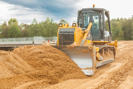 agricultural engineering: bulldozer moving sand