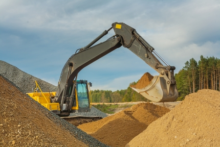 excavator moving sand photo