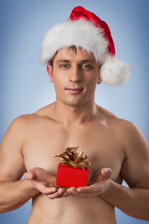 portrait of muscular men in santa cap photo