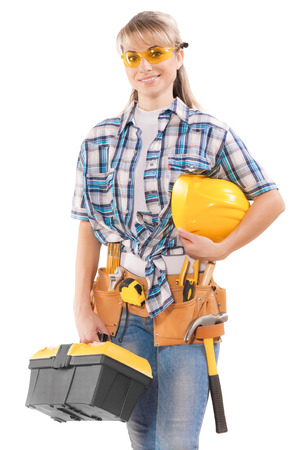 safety googles: beautiful female worker with tools Stock Photo
