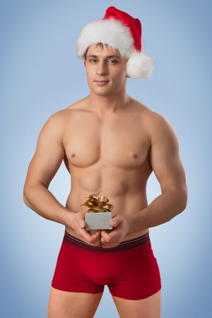 handsome man with santa cap photo