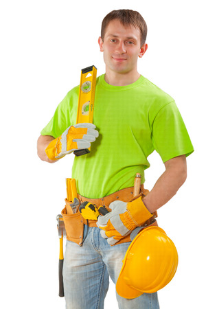 class maintenance: young construction worker holding level isolated white background Stock Photo