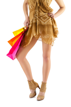 beautiful female legs and paper bags in hand isolated Stock Photo - 25640586