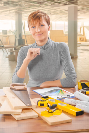female worker sitting at table with tools photo