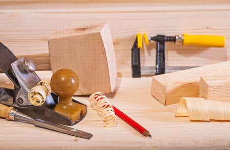 woodworking plane with other tools on wooden board photo