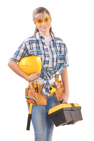 safety googles: beautiful female wearing working clothes with tools isolated on white background Stock Photo