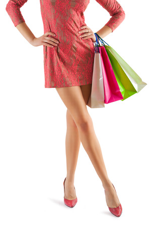 close up view on beautyful female legs and paper bags in her hand Stock Photo - 26579114