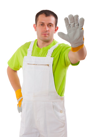 young man wearing working clothes isolated on white background photo