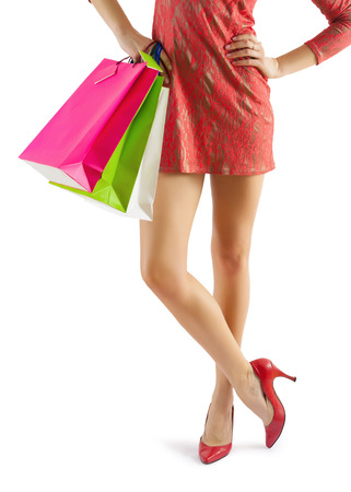close up view on beautiful female legs and hands with paperbags Stock Photo - 27081663