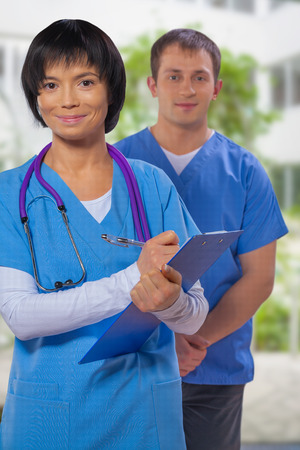 portrait of a medical team on a background of blurred hospital photo