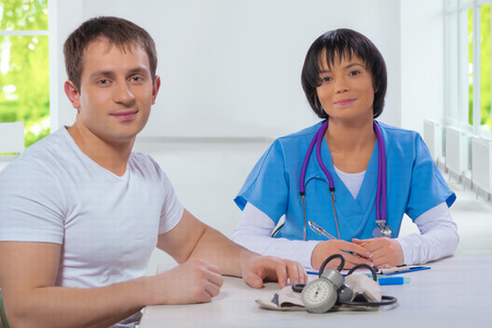 female doctor and patient looking at camera    selective focus on doctor photo