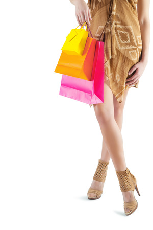 paperbags: very close up view on female with colored paperbags in hand isolated on white Stock Photo
