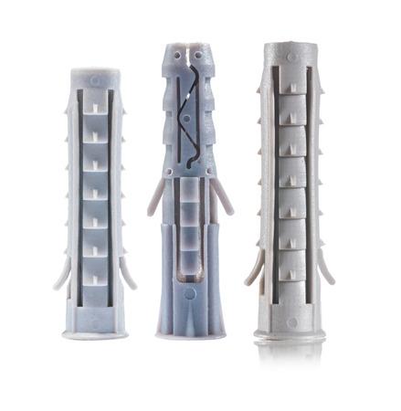 three plastic wall anchors isolated photo