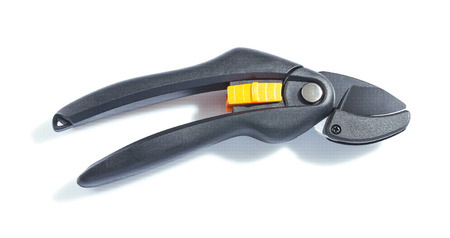 Closed black secateurs isolated on white background photo