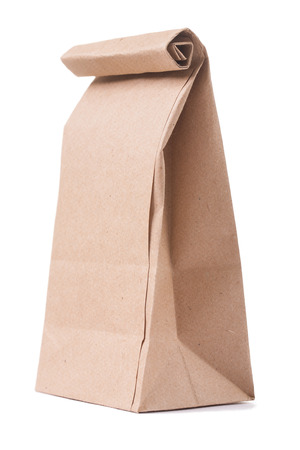 negocios comida: cl�sica bolsa de papel marr�n sobre fondo blanco