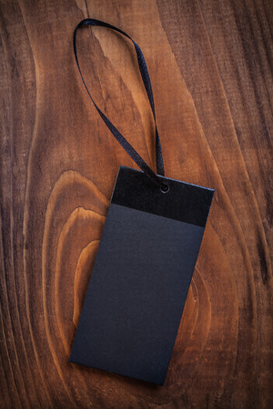 black price label tag on old wooden board photo