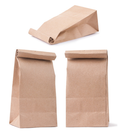 set of classical brown paper bag in three different foreshortenings isolated on white photo