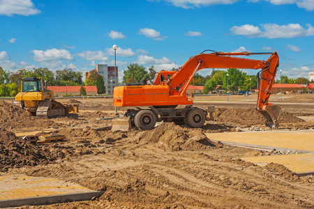construction machinery: excavator on construction site Stock Photo