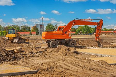 mine site: excavator on construction site Stock Photo