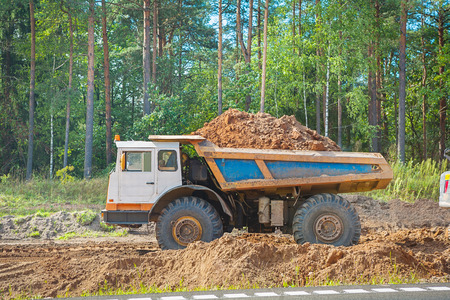 dumptruck: old tipper vith clay ground in forest