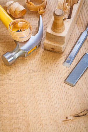construction tools: chisel hammer woodworkers plane on wooden board Stock Photo