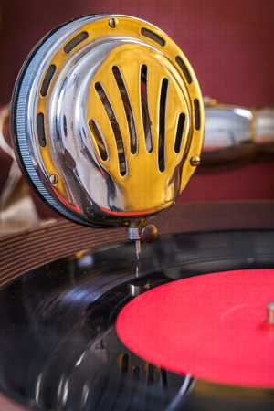 gromophone speaker on vinyl disk close up photo