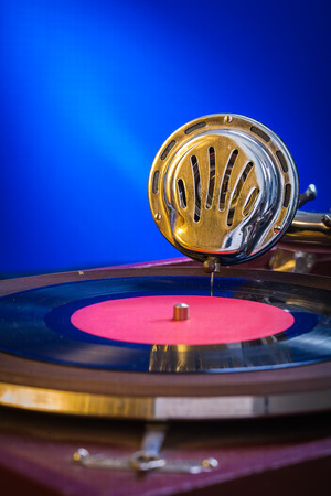 very close up view on gramophone on blue background photo