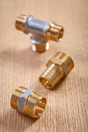 household fixture: brass plumbing fixtures on wooden baords Stock Photo