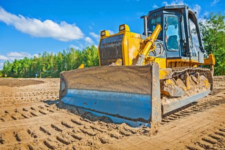 모래에 buldozzer 스톡 콘텐츠