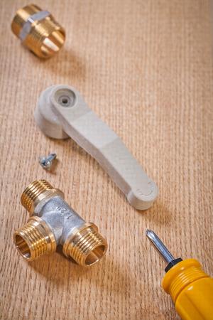 household fixture: plumbing fixtures screwdriver on wooden board